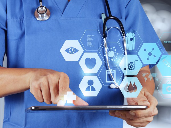 Doctor with tablet and healthcare symbols