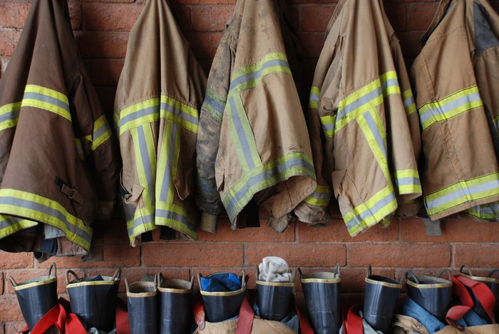 Firefighter gear lined up and ready for use.