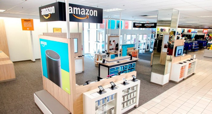 A collection of Amazon devices displayed in the front of a Kohl's store