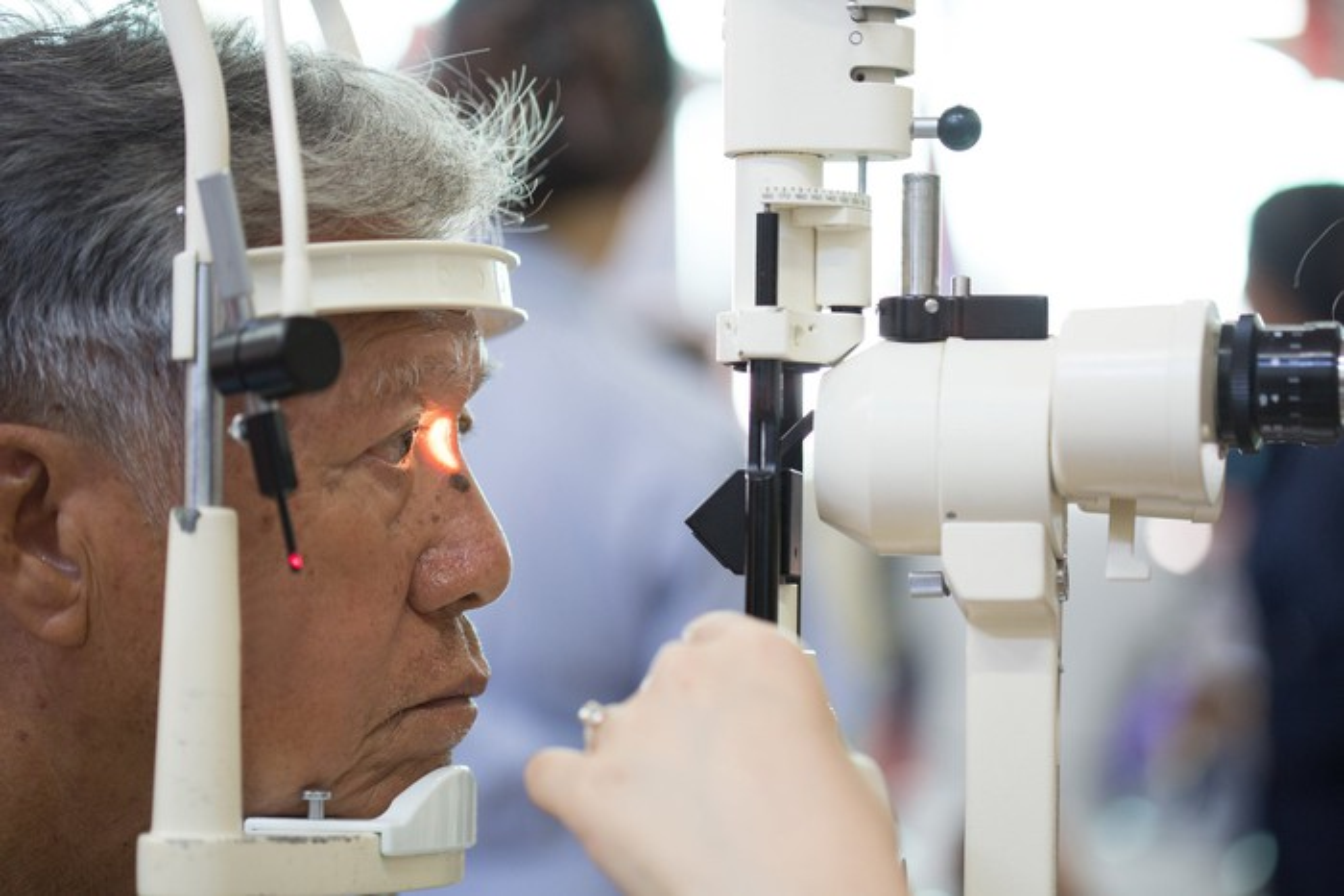 senior man getting eye examination