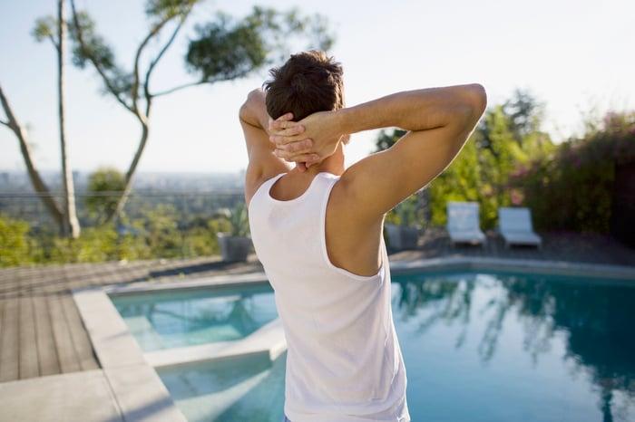 Man stretching at pool
