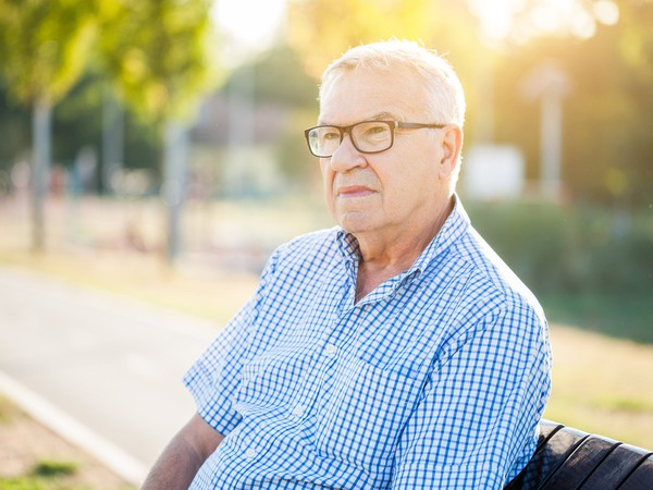 senior man in glasses outdoors_GettyImages-842793342