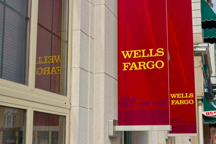 Red banners hanging outside a Wells Fargo branch.