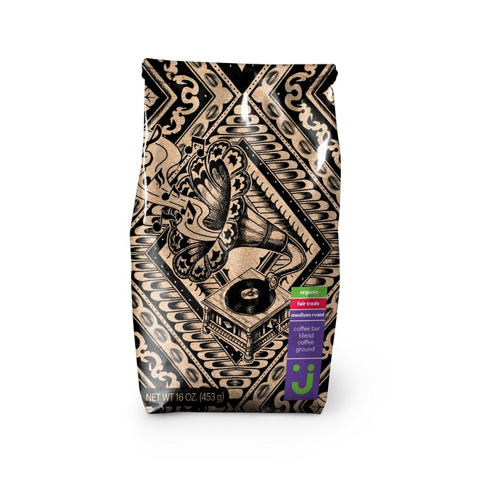 "Bag of ground coffee labeled ""organic"" and ""fair trade,"" in packaging with stylized phonograph and musical notes"