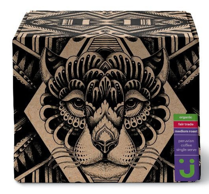 Box of organic fair-trade single-serve coffee pods dominated by a stylized lion's head