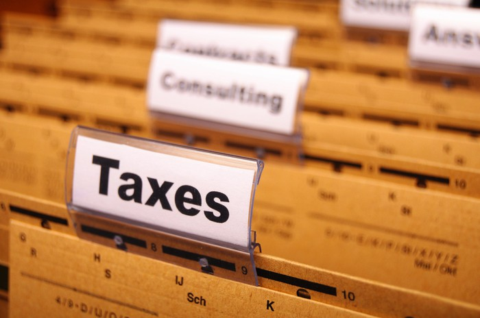 "Close up of folders in a drawer, with the one in front labeled ""Taxes"""