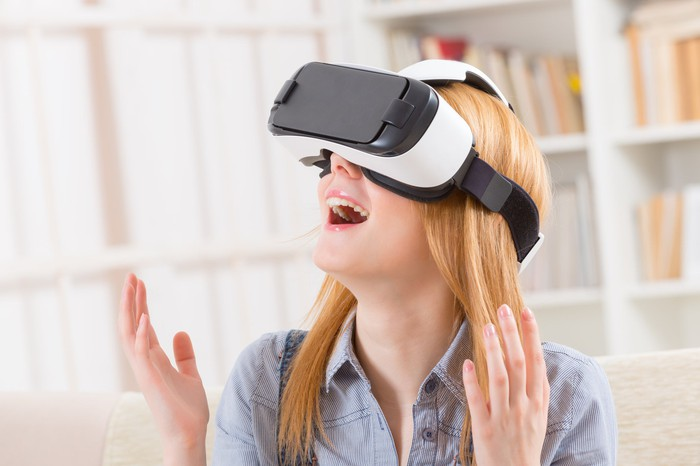 A woman uses a VR headset.