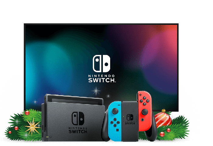 A Nintendo Switch console and controller in front of a television and some holiday decorations.