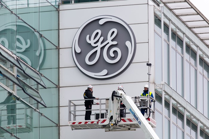 A GE logo being installed on a former Alstom building