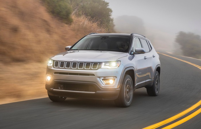 A silver 2017 Jeep Compass, a compact SUV, on a mountain road.