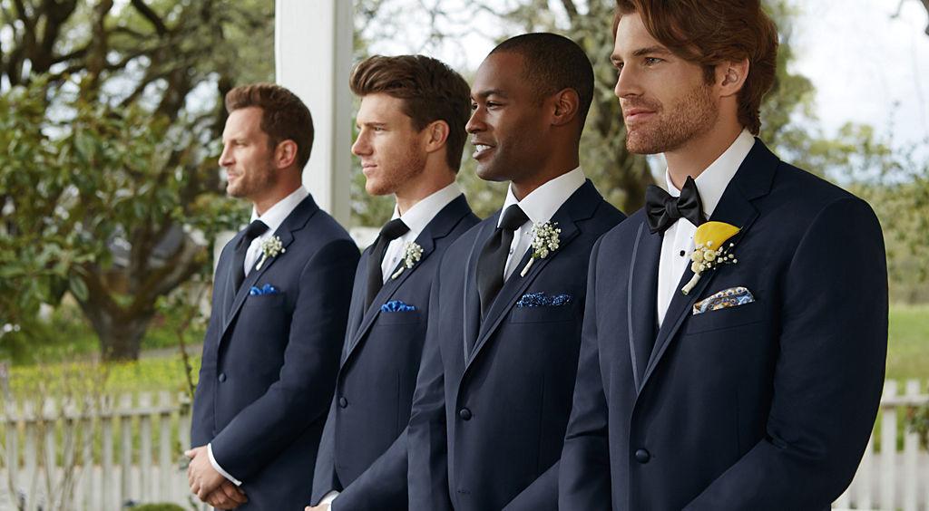 Four men wearing tuxedos.