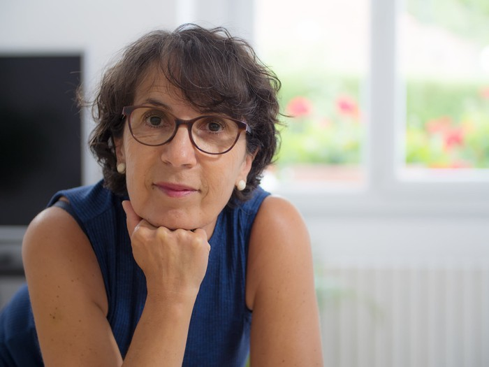 middle-aged woman in glasses looking directly at camera