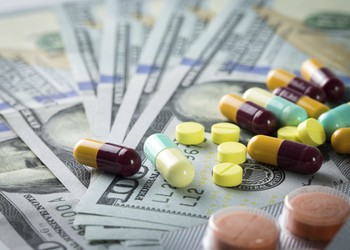 Colorful drugs on top of hundred dollar bills