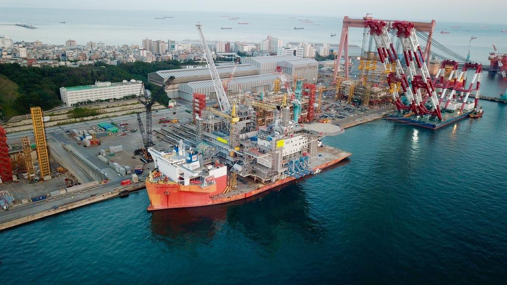 Ship loading oil platform in dockyard.