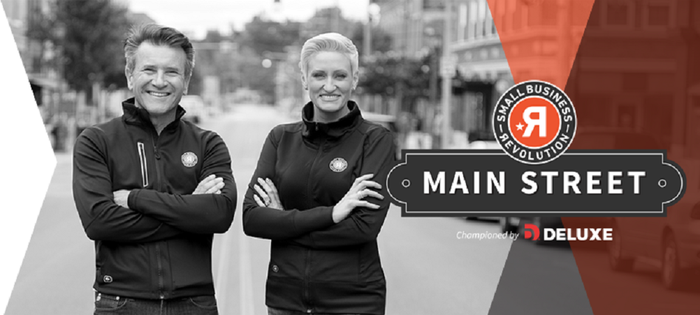 Robert Hervajec and Amanda Brinkman in matching outfits on a Main Street in a small town, with graphics for Deluxe's Small Business Revolution program.