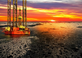 Offshore Drilling Rig Sunrise Over a Frozen Sea