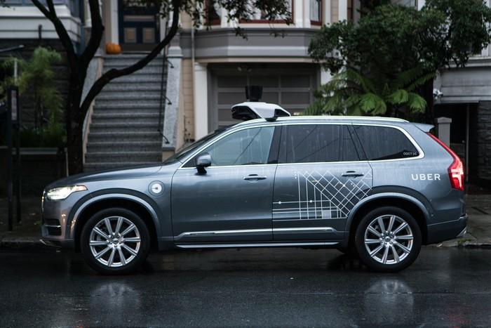 Uber's autonomous Volvo sitting on a road.