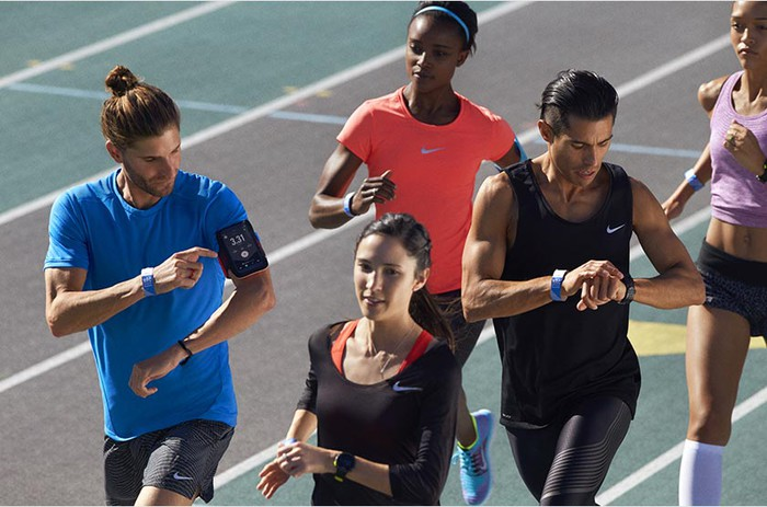 A group of runners on a track wearing Nike gear.