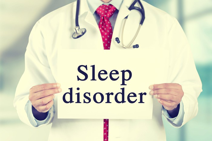Doctor holding sign that says sleep disorder