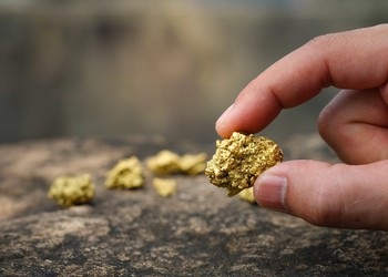 holding_gold_ore