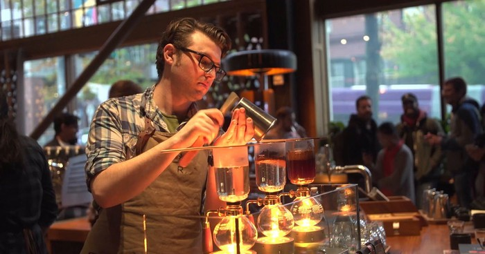 Starbucks Roastery barista making several coffee drinks.