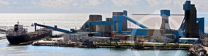 Compass Minerals salt plant on a coastline with cargo ships ready to pick up shipments.