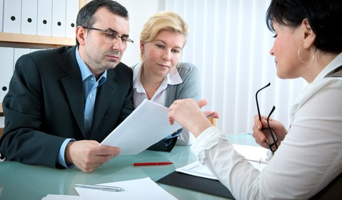 40-something couple meeting with investment advisor --GettyImages-96367353