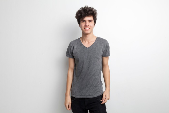 Young male in gray t-shirt with big hair
