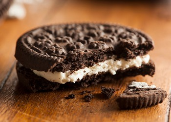 Broken chocolate cookie with cream filling