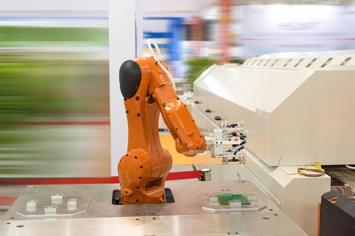 A robotic arm on an assembly line.