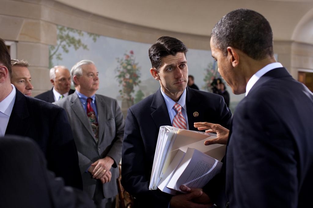 Former President Barack Obama speaking with House Speaker Paul Ryan.