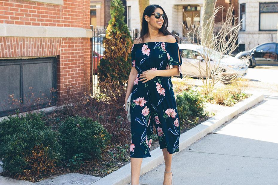 A woman walking outside wearing print outfit.