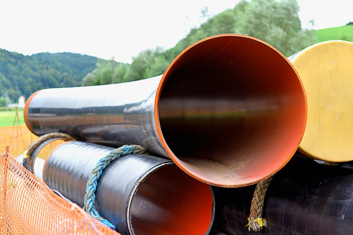 A stack of coated pipes.