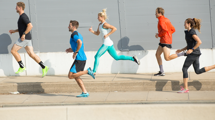 Runners wearing Under Armour shoes and apparel.
