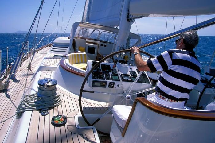 Man steering boat.