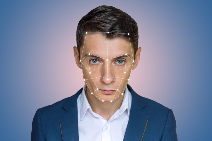 young man with facial recognition map superimposed on his face