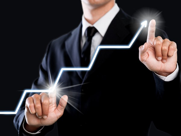 businessman-pointing-to-lighted-chart