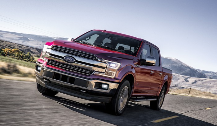 A red 2018 Ford F-150 pickup truck.