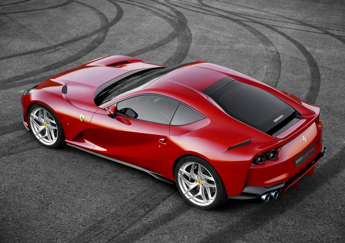 A red Ferrari 812 Superfast, a two-seat sports car, viewed from above.