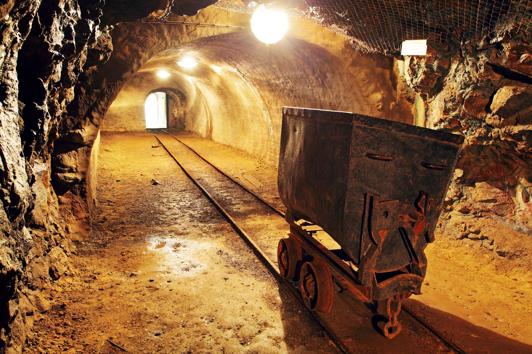 Gold mine underground with rail track.