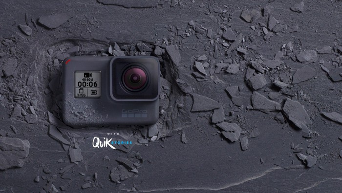 GoPro's HERO6 Black camera facing up on the ground surrounded by broken rocks
