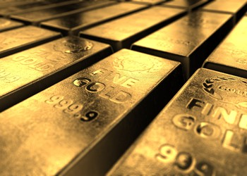Gold Bars on Dark Background Getty