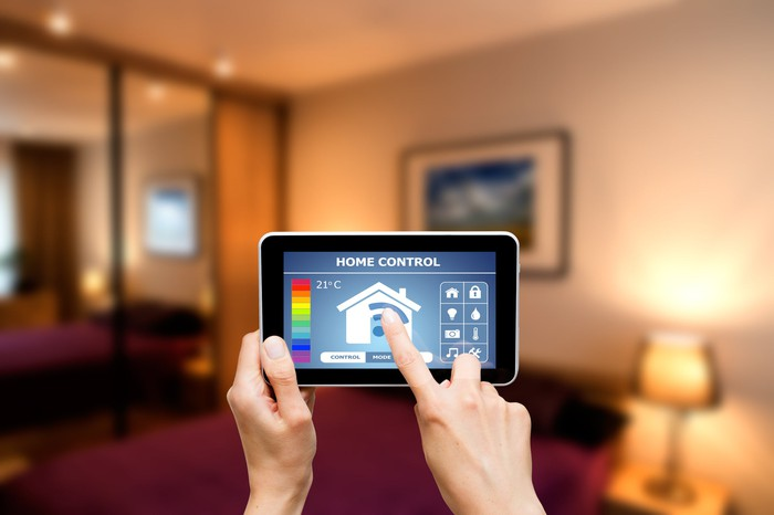 Person controlling a smart home with a tablet