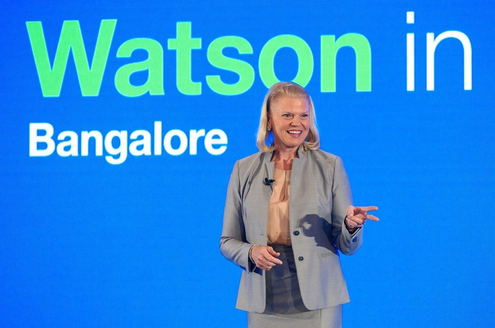 "IBM CEO Ginni Rometty in front of a sign reading ""Watson in Bangalore"""