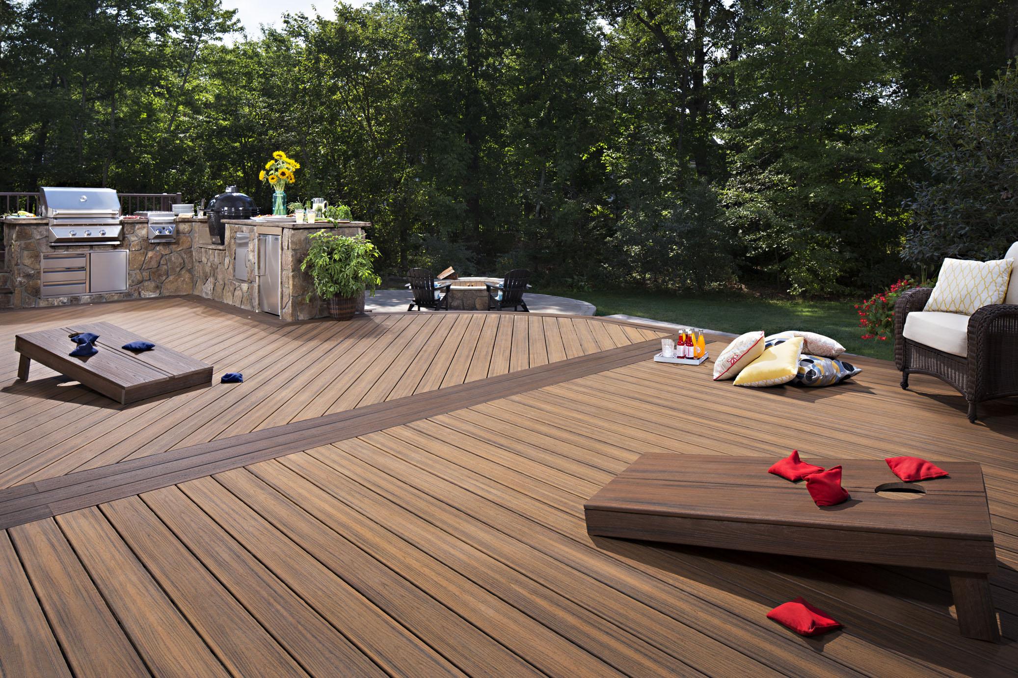 An outdoor Trex patio with a bean-toss game.