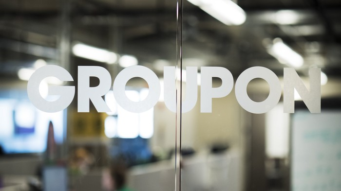 Glass door at Groupon office with Groupon written on it.