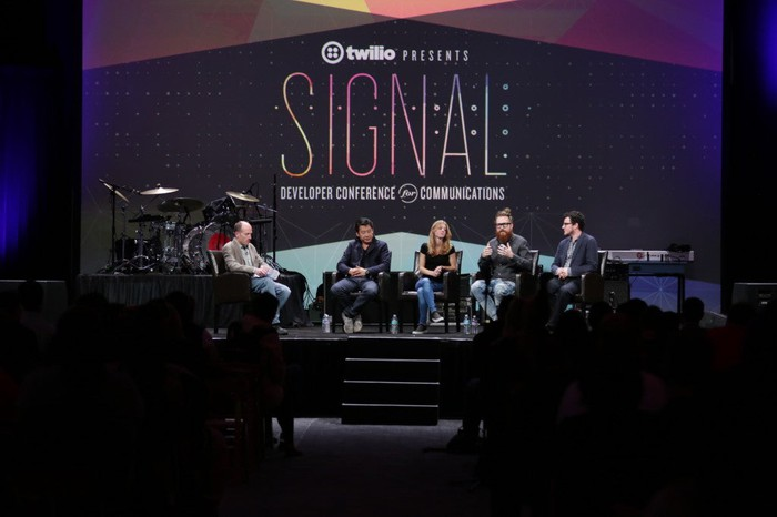 Five people on the stage at an early Twilio Signal conference for developers.