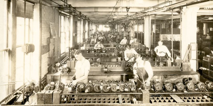 historical pic of men working in manufacturing at an Emerson Electric plant