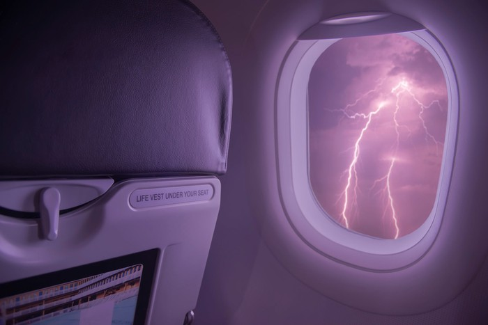 Lightning viewed from inside an airplane cabin