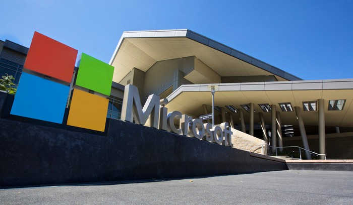 Picture of the outside of a Microsoft building with its logo in front.